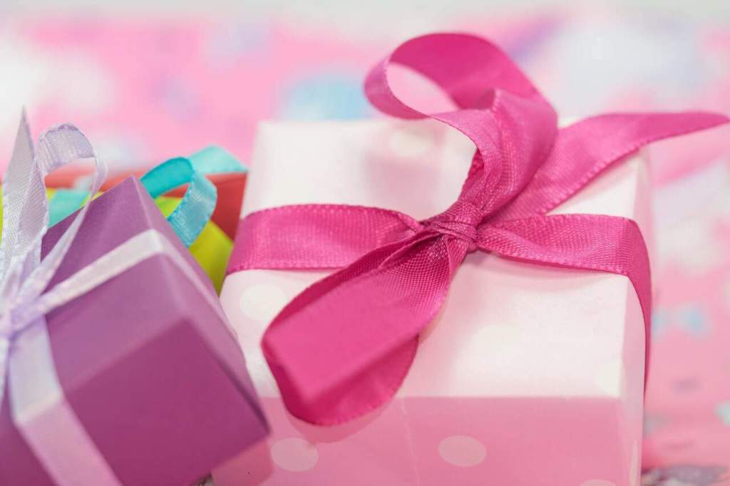 Pink and purple wrapped gifts for the mom who doesn't want anything.