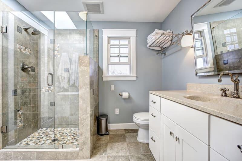Clean, minimalist master bathroom.