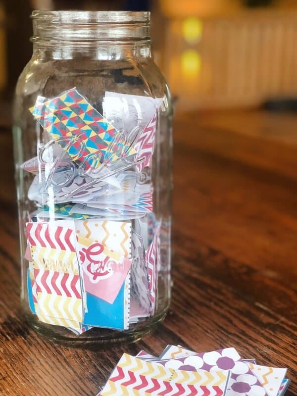 Gratitude jar with slips of paper in it from the free gratitude jar printable.