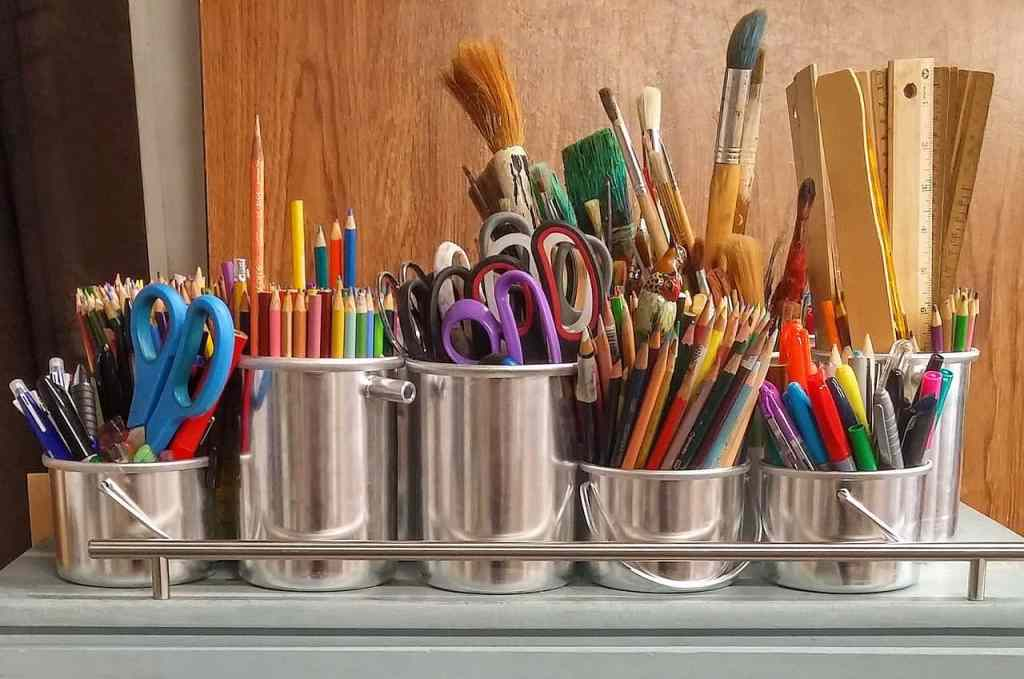 craft supplies in small metal storage containers