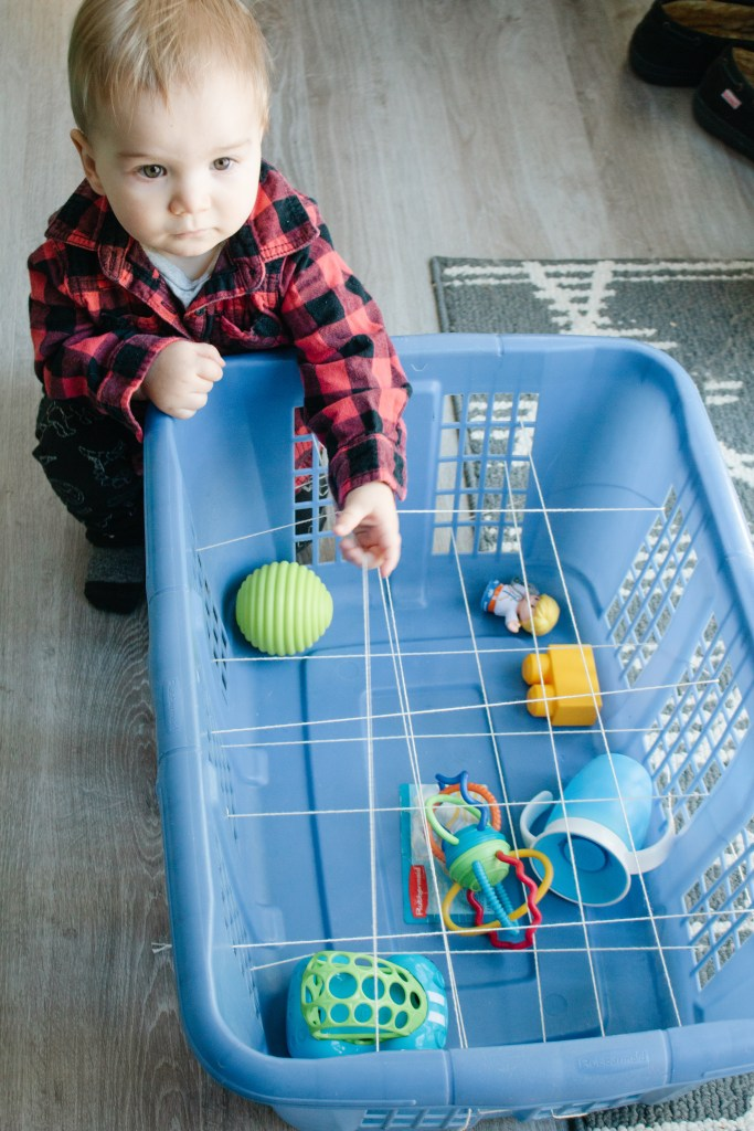 This is a really fun activity for 9 - 12 month olds as they have to navigate through the string to pull out their favourite toy.