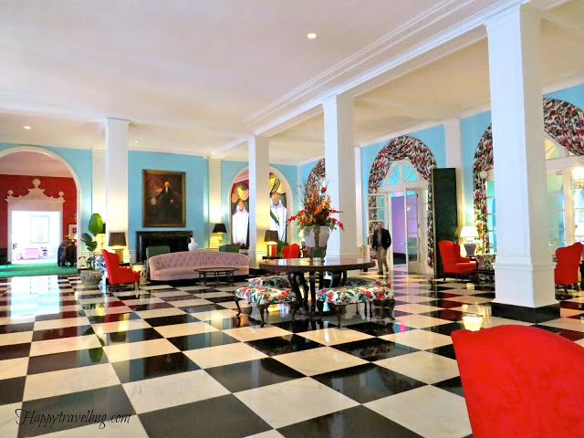 large room at the Greenbrier with a fireplace