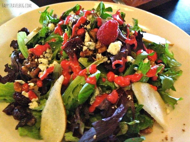 salad of baby green, walnuts, blue cheese, dried cherries, pears