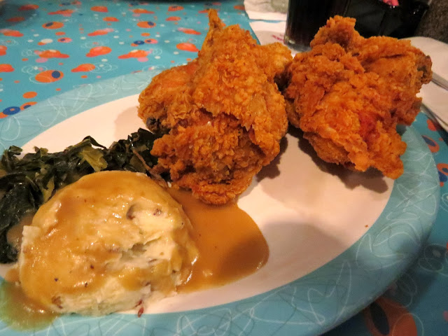Fried chicken, mashed potatoes and gravy and greens at the 50's Prime Time cafe