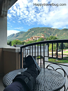Relaxing on the Broadmoor balcony with my boot