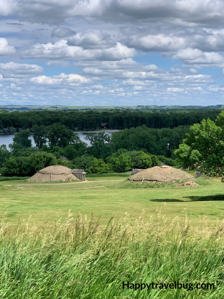 Slant Indian earth lodges on the sloping land overlooking the Missouri River
