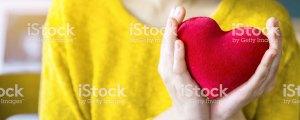 Woman holding stuffed heart