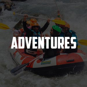 "The word ""Adventures"" over girls white water rafting"