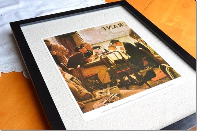 A framed print lying on a table
