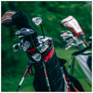 Two golf bags full of clubs standing next to each other-image by igor ovsyannykov unsplash.com