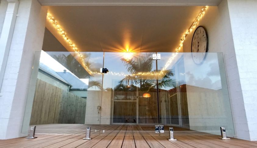 glass pool fence on wooden deck