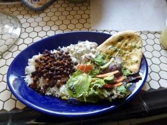 Choli with white basmati rice, raita, garlic naan and green salad