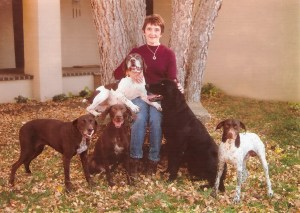 Portrait of Linda Harkey with her dogs