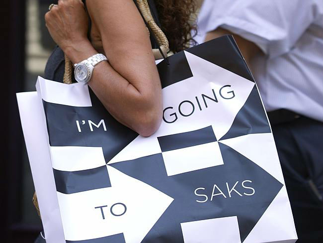 Posh ... A shopper holding a Saks shopping bag walks on Fifth Avenue in New York