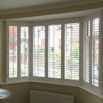 Harmony Blinds Ltd Full Height Shutters In An Angled Bay