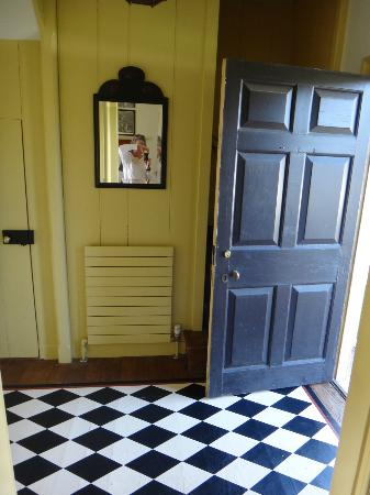 yellow room with black and white floor