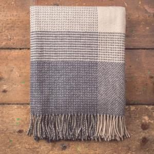 grey and white checkered blanket with tassels