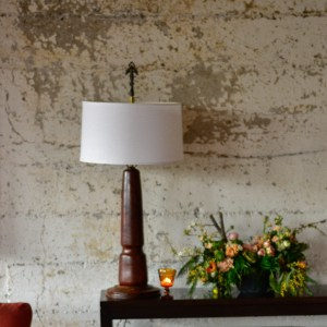 Vintage mahogany lamp on a side table with decor