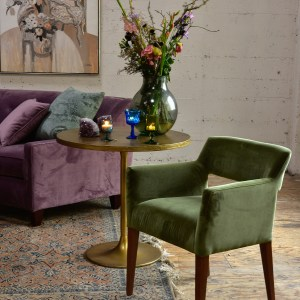 green velvet side chair in a living room with furniture and decor