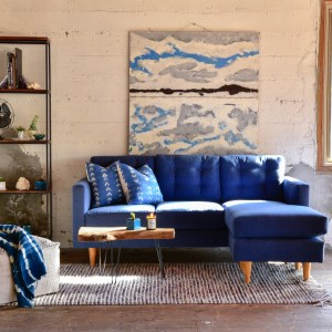 Blue sofa in living room with furniture and decor
