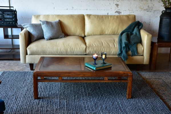 Vintage wood coffee table in living room with decor