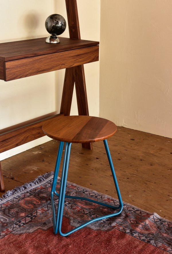 wooden stool with blue steel legs