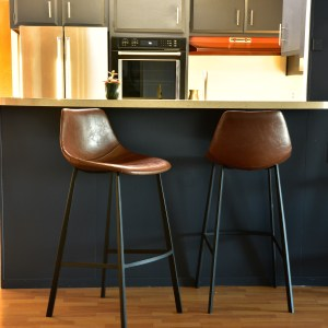 brown leather bar stools at kitchen counter