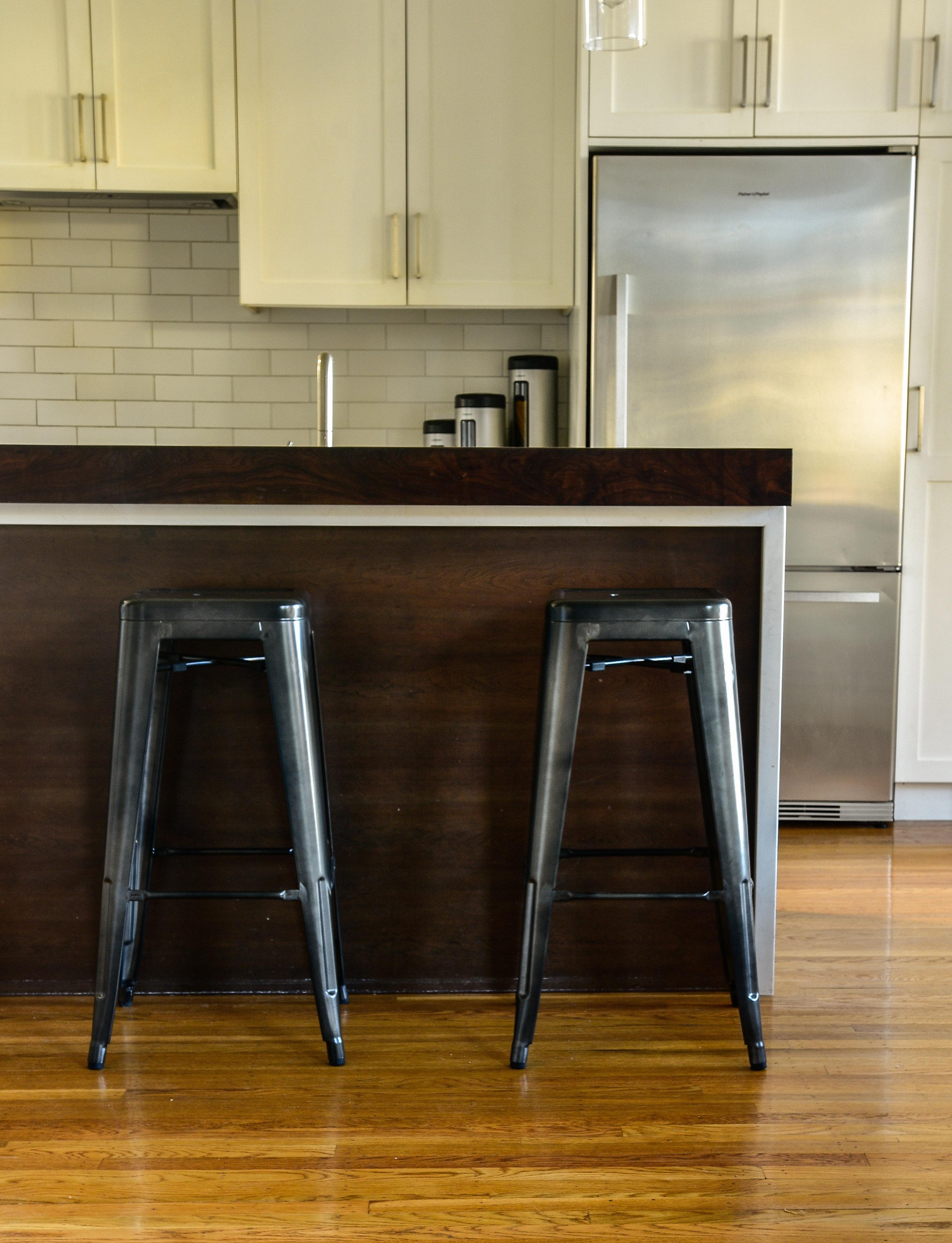 Tall metal bar stools at kitchen counter