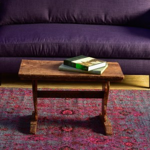 Purple sofa in living room with coffee table
