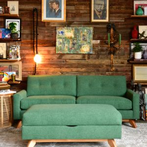Green ottoman and sofa in living room