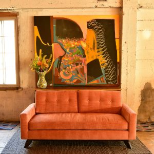 orange sofa in a living room with furniture and decor
