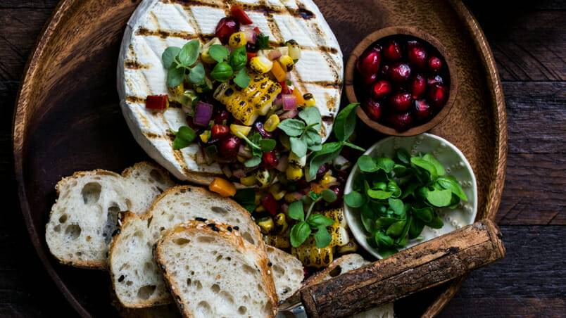 The Food Gays' Campfire Brie with Grilled Corn Salsa