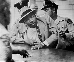 Martin Luther King Jr. being arrested in Montgomery, Alabama in 1958, the year before his speech in Hartford.