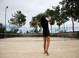 Tennis player at the court of Haruhay Dream Resort