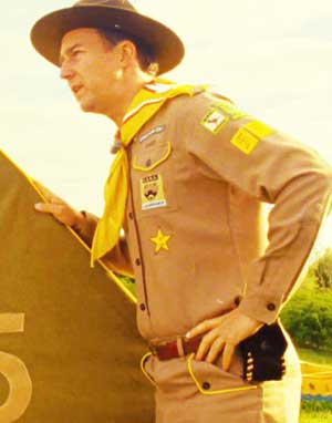 image of ed norton in character as Scout Master Ward