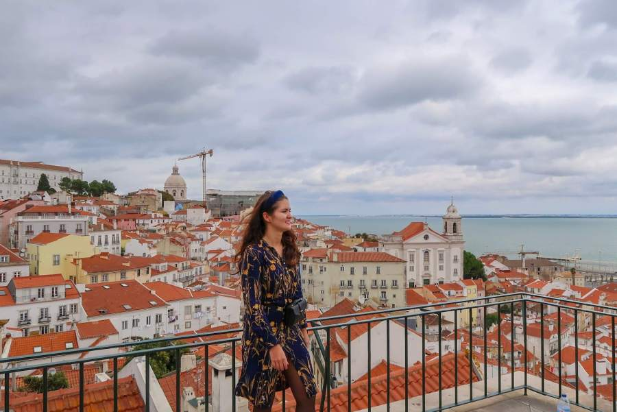 Explorer Melissa with view of Alfama, Lisbon from one of the many viewpoints. Picture owned by Hashtag Explorers