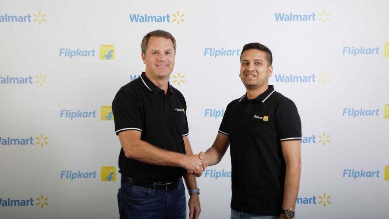 Walmart CEO Doug McMillon and Flipkart Co-Founder and CEO Binny Bansal during an programme to announce Walmart Inc.'s acquisition of Flipkart 77% stake, in Bengaluru on May 9, 2018. (Photo: IANS)