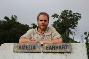 Josh Gates on the Lae Runway in Papua New Guinea, the last location Amelia-Earhart took off from before her disappearance
