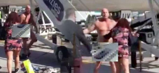 Uçak pistinin ortasında çırılçıplak soyundu