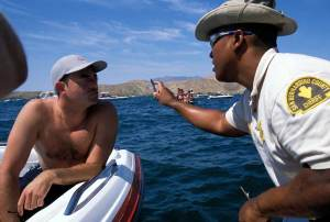 A-sheriff-deputy-gives-a-boater-a-sobriety-test-at-Lake-Havasu-on-Memorial-Day-weekend