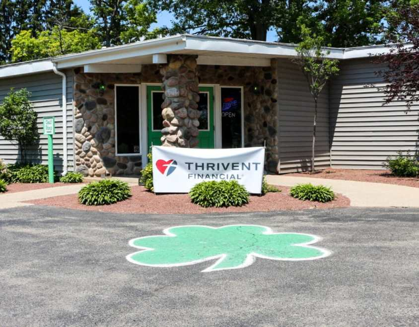 Sponsor Thrivent's sign at the entrance of the course.