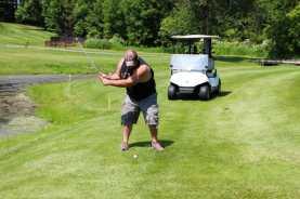 Ben golfing