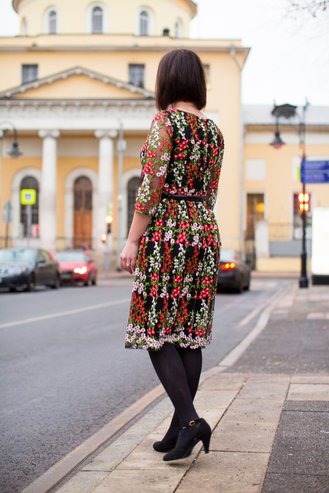 wearing a floral dress for the holidays