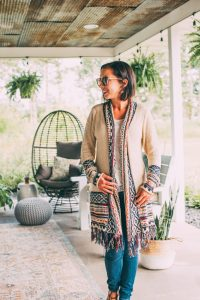 Lindsey of Have Clothes, Will Travel wears a boho Salty Crush cardigan with fringe