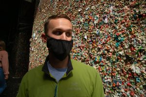 My husband wearing a face mask at the Gum wall in Seattle when we visited during COVID-19