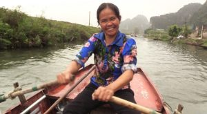 Cheerful sampan lady at Tam Coc, North Vietnam - Halong on land