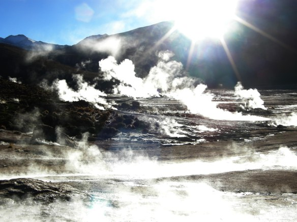 Geysers steam in the early morning light at El Tatio in the Andes Mountains in northern Chile.