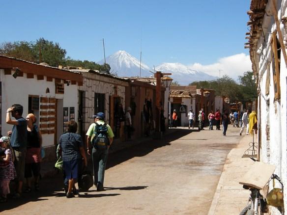 Street in San Pedro de Atacama with Licancabur volcano in the distance.