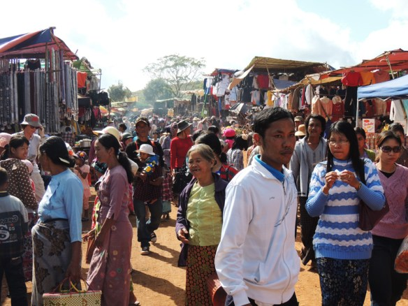 A crowded market in the festival grounds near Shwezigone Pagoda, northern Myanmar.
