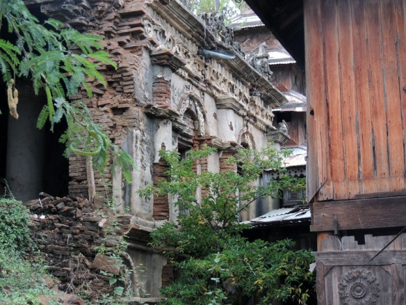 Crumbling old colonial buildings in the small riverbank town of Sale, Myanmar.